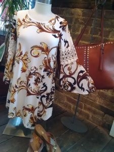 Appropriately draped in spiced caramel and cocoas.  Try it with a studded tote at Lovely's Boutique!