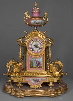 French antique clock set in pink jeweled porcelain and ormolu, with silver highlights