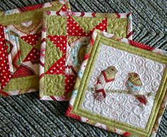 Love these Christmas holiday mug rugs. Please notice the amazing quilting,
