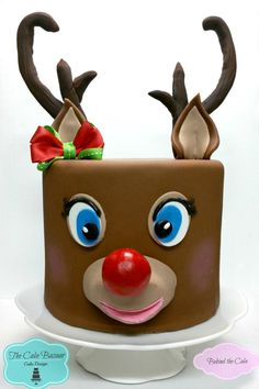 Behind the cake - Cake decorated with fondant as a reindeer cake with molded antlers and red nose cake decorating recipes kuchen kindergeburtstag cakes ideas Fondant Christmas Cake, Christmas Themed Cake, Christmas Cake Designs, Christmas Cake Decorations, Holiday Cakes, Christmas Goodies, Christmas Treats, Christmas Cakes, Xmas Cakes