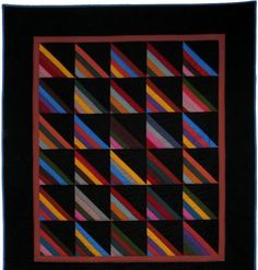 I showed you a companion quilt to this one a while back. I finally was able to take a photo of this one for you. The difference between the...