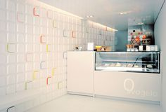 "Commissioned to realize the new Olivogelo ice-cream shop, Andy Martin Architects designed bespoke ""lickable"" tiles with hints of colored flavours to cover a wall. Bakery Shop Interior, Interior Design London, Contemporary Interior Design, Chocolate Boutique, Chocolate Shop, Shop Front Design, Store Design, Store Layout, Cheese Shop"
