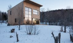 When a young carpenter with a modest budget wanted to build his first home, he turned to Atelier l'Abri for help with the design. The Montreal-based architecture firm responded with a modern and uncomplicated design for a cabin that recedes into its forested surroundings of Bolton in Quebec's Eastern Townships. The self-build project is l'Abri's first built house design and is named Wood Duck in reference to the project's use of timber for the structure, cladding, and interior finishes.