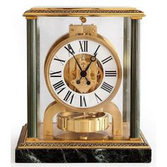 Atmos clock in gilt metal on marble base by Jaeger-Lecoultre, 1960.