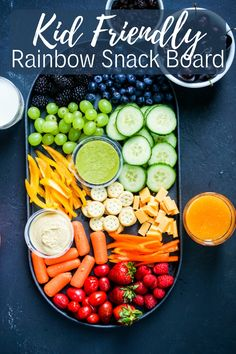An easy to put together, fun, delicious and wholesome snack platter in rainbow colors that kids will love. Perfect for play dates, birthday parties and picnics. #rainbowsnackplatter #rainbowsnacks #rainbowsnackboard #kidfriendly #kidfriendlyfood #kidssnacks Vegan Snacks, Healthy Snacks, Snack Recipes, Dinner Recipes, Cooking Recipes, Healthy Recipes, Delicious Recipes, Snacks Ideas, Eating Healthy