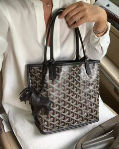 All you need to know about Goyard's three classic totes: the Saint Louis, Artois and Anjou. Prices, sizes, and descriptions included. Goyard Handbags, Goyard Bag, Chanel Handbags, Leather Handbags, Goyard Tote Price, Designer Totes, Designer Bags, Designer Handbags, How To Make Purses