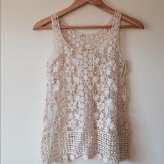 NWOT Cream Crochet knit tank Adorable crochet tank, tag missing.  XS. Smoke free, pet friendly home.  NWOT Tops Tank Tops