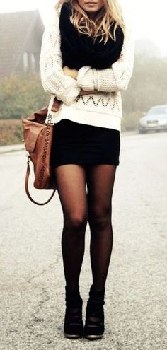 black scarf, knit sweater layered over black dress/skirt, black tights and black shoes