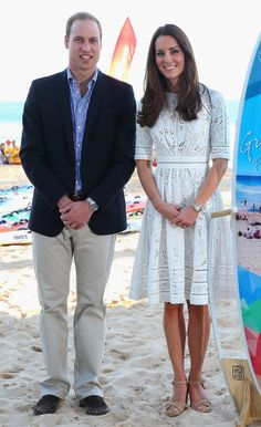 How does royalty dress for the beach? In this case, a navy blazer and a lacy Zimmermann dress. #KateMiddleton