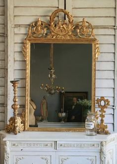 i like the mix of the formal and ornate with simple elements that are very informal and relaxed.  fresh, fun, feminine.