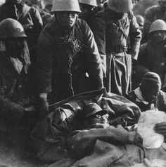 Tired Japanese army veterans after heavy fighting, Peking (Bejing) 1937.