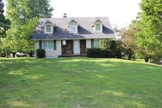 Beautiful country home w/ shop, barn, above ground pool and deck on almost 10 acres. Unfinished basement has garage/workroom, could be finished for more space, wood furnace/elect. furnace w/ electronic air filter, Andersen windows, perfect setting for kids & animals to grow. Check it out today! in Marshfield MO