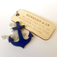 Anchor for the Soul Necklace with Hebrews 6:19 by TCMBDesign. Laser Cut anchor dyed with blue india ink. Wooden tag is etched with Hebrews 6:19 - We have this hope as an anchor for the soul, firm and secure. Christian jewelry, bible verse jewelry.