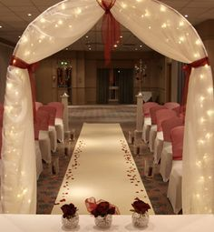 add more flowers to this arch as it is and it will look more grand. it looks plain here, even with the lights.