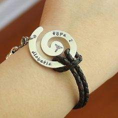 Leather Medical Alert Bracelet  - aluminum swirl - brown leather cord - silver & stainless findings - medical alert symbol stamp on Etsy, $39.00