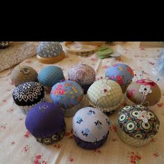 Pincushions - I like the use of fabric design for a little drama instead of embroidery or adornment.  (No instructions.)