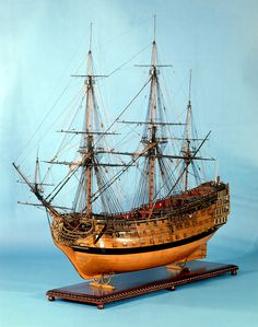 SLR0449 Description Scale: 1:34.3. A contemporary full hull model of the 'Victory' (1737), a 100-gun three-decker first-rate ship of the line. Built in 'bread and butter fashion' and finished in the Georgian style, the model is partially decked, fully equipped and rigged. The large scale of this model would support the theory that this was once part of the equipment of the Royal Naval Academy at Portsmouth Dockyard, and used for the educating of young gentlemen to the sea-service. In fact…