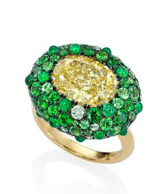 Sotheby's Shamrock Ricci Ring fancy brownish yellow, 5.24ct, oval brilliant cut diamond. Mounted in 18k yellow gold with a pavé-set surround of tsavorites, sapphires and emeralds - DuJour