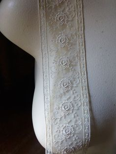These are exquisite embroidered lace trims.... made in France, superior quality.  This color is a deeper, antique colored ivory.  Measures 5 cm or 2 in width.  Listing is for ONE yard .... additional quantities will be shipped as continuous yardage...  We have this also in white and a charcoal gray, listed separately. May order in other colors depending upon popularity.  **************  More lace, stretch lace, appliques, flowers, leaves and other lovelies located here:  LACES…