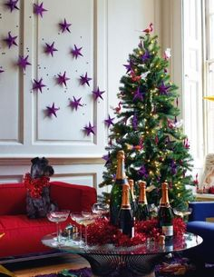 Awesome matching tree decor w wall decor....cute idea. Looks nice. Especially love the deep metallic purple color they're using.