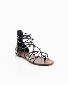 Embellished Gladiators with back heel beading and stud details.  Available in black patent or pewter metallic.