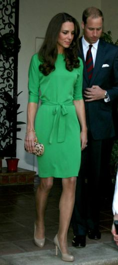 The newlyweds arrive at a private reception at the British Consul-General's residence in L.A., sporting a green silk Diane von Furstenberg frock - June 8, 2011