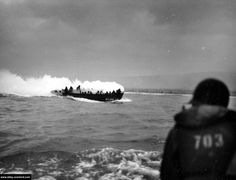 June 1944, Omaha Beach.  Landing of the second wave, 116th Infantry Regiment, 29th Infantry Division.