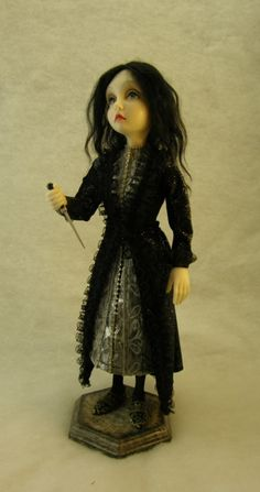 Fine art doll: polymer clay, hair, and fabric.