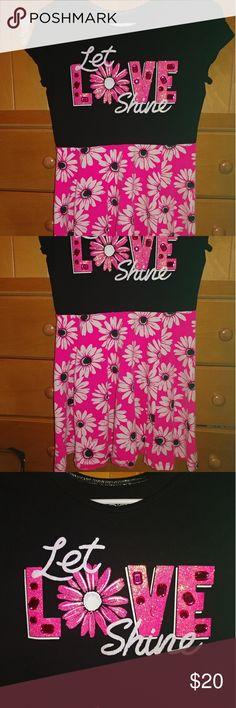 Justice Girls Dress Size 14 Justice dress in a size 14. Top portion is black with let love shine down. The bottom portion is hot pink with black and white flowers. One rhinestone is missing off the word love. Otherwise in excellent used condition. Justice Dresses Casual