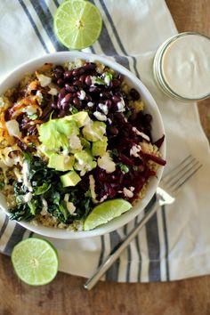 Quinoa, beet, and black bean burrito bowls with caramelized onions and cumin-lime tahini | theroastedroot.net #vegan #vegetarian #recipe #paleo #healthy @roastedroot