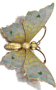 AN ART NOUVEAU ENAMEL AND DIAMOND BROOCH, LATE 19TH CENTURY. Designed as a butterfly, the wings and antennae decorated with polychrome plique-à-jour enamel, detachable brooch pin, French assay marks. #ArtNouveau #antique #brooch #AntiqueJewelry