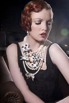 Ropes of pearls with vintage playing card butterflies...fun!