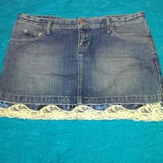 """Guess Denim Skirt with satin & lace trim Guess Jeans Denim mini skirt with satin/lace slip peekout. Blue satin, cream lace.  5 functional pockets. Skirt is 14"""" long including slip peekout.  Great condition. Barely worn Guess Skirts"""