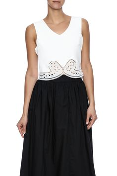 White v-neck crop top with lace trim detailing.Fully lined with a hidden side zipper closure.   White Crop Top by LUNA. Clothing - Tops - Sleeveless Clothing - Tops - Blouses & Shirts Clothing - Tops - Crop Tops Michigan