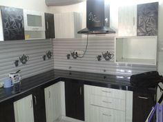 Floral self designed Black and White modular Kitchen