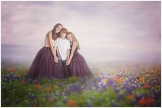 Three siblings in a digital fine art composite in a field of flowers.  Taken in Fairmont, WV and composited by Amy Sine Photography.