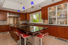 Modern Kitchen with High ceiling, Breakfast bar, Glass panel, Pendant light, Limestone Tile, Kitchen island, Stone Tile