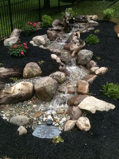 A nice pondless waterfall. Was installed as a dedication feature to a family who lost there 18 year old son. Backyard Stream, Backyard Water Fountains, Diy Water Fountain, Backyard Water Feature, Ponds Backyard, Waterfall Landscaping, Garden Waterfall, Front Yard Landscaping, Diy Pondless Waterfall