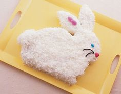 Give this cute bunny a charming face with jelly beans, Jordan almonds, and black licorice.  Recipe:  Pineapple-Coconut Bunny Cake   - CountryLiving.com