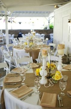 burlap on the tables w/ yellow florals