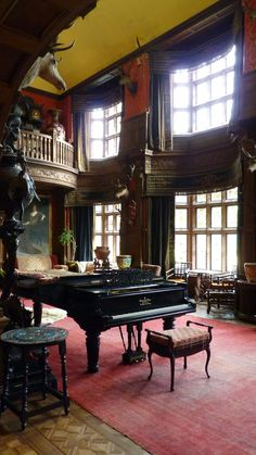 The piano room and sitting areas. The animal heads on the walls are magical creatures hunted over the generations.