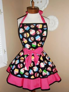http://img.loveitsomuch.com/uploads/201212/03/cu/cute%20cupcake%20print%20womans%20retro%20apron%20with%20tiered%20skirt%20and%20bib....plus%20size-f71473.jpg