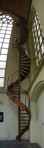 Tall, narrow, wooden, spiral staircase by hugovk, via Flickr