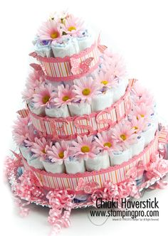 Super cute gerber daisy decorated diaper cake for a baby girl's shower.