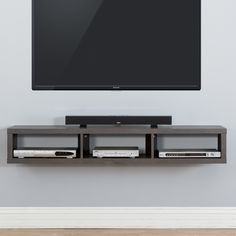 Features:  -Walnut finishes.  -Holds 3 audio/video components and a sound bar to…