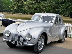 Ultra-rare Aston Martin dating from World War II. Finished and registered in 1940, this Aston Martin Atom is one of the oldest concept cars in the world. (carbuzz.com)