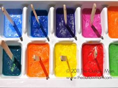 Ice cube painting is one of my FAVORITE art activities because it's such a sensory experience! The ice paints change consistency the longer you play with them! I'm interested in the inclusion of sticks here - I think I prefer it without... less tasting that way! Heehee!