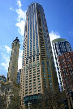 The tower to the left is part of the old Chicago water tower and pumping station, one of the few buildings to survive the great fire in Illinois State, Chicago Illinois, Chicago Water Tower, Lago Michigan, Chicago Buildings, The Great Fire, Luxury Condo, Chicago City, My Kind Of Town