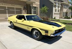 1971 Ford Mustang Mach 1: Grabber Yellow, 351 Windsor - 4bbl., 4-speed manual transmission, ram air, dual exhaust w/competition headers and Flowmaster mufflers.