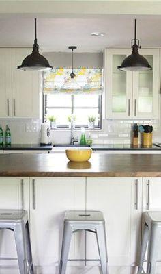 I need these stools! A light and bright remodel of a 1950's kitchen by Cape 27 featured at Remodelaholic.